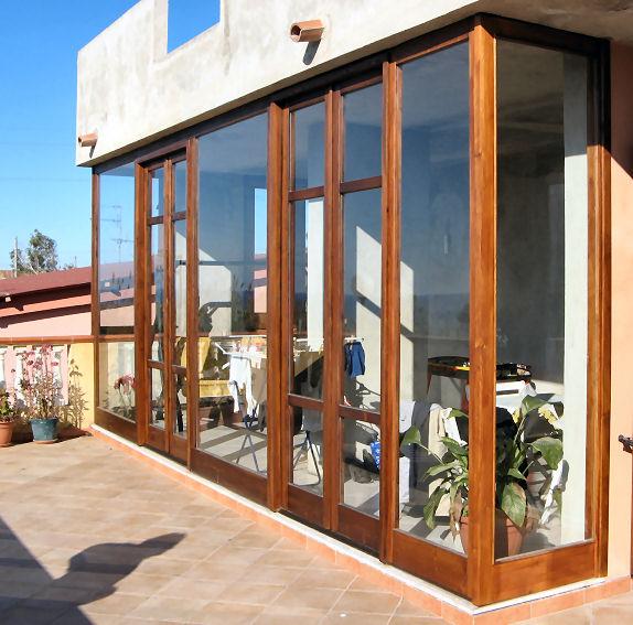 Verande in legno for Veranda con caminetto a gas schermato